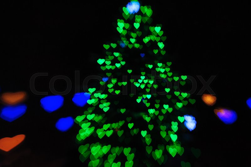 Green lights on the Christmas tree in the form of hearts blurry, stock photo
