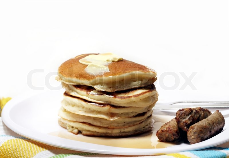 Pancakes and sausage with butter and syrup Stock Photo Colourbox