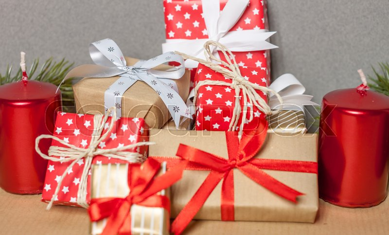 Pile of different beautiful christmas gifts and candles | Stock ...