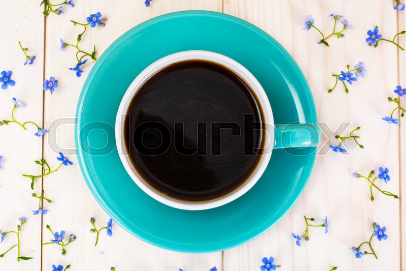Cup of Coffee with Flowers. Studio Photo, stock photo
