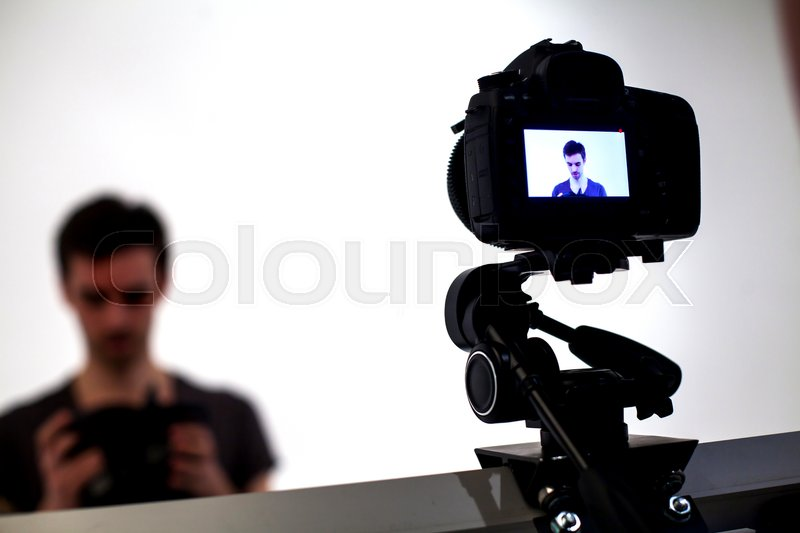 Backstage from video studio with man going to wear virtual reality headset, stock photo