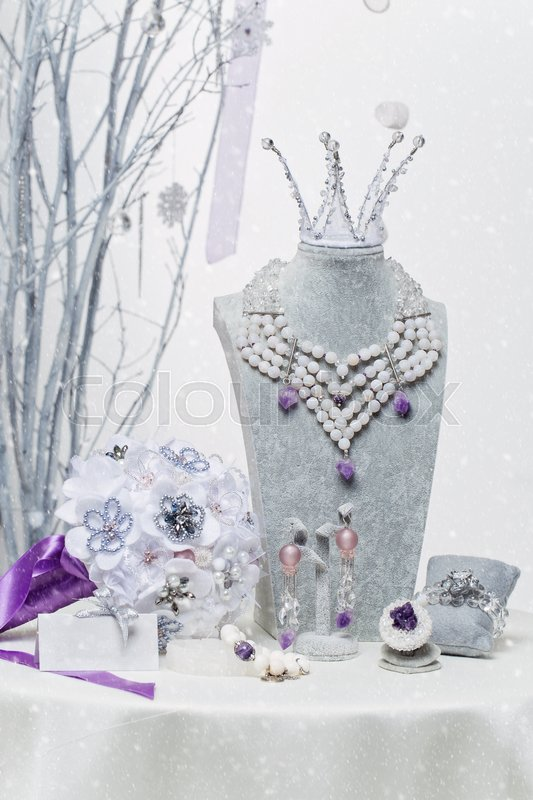 Beautiful set of natural stone bridal accessories including necklace, ring, earrings, bracelets, princess crown and wedding bouquet. , stock photo