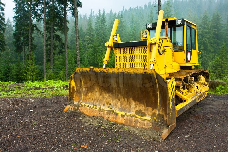 Stock image of 'Heavy machine used for deforestation in clearing'