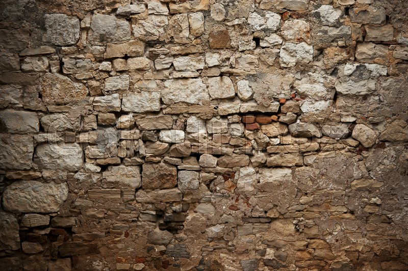Old fortress wall of different sizes bricks, stock photo