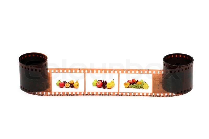 Filmrolle mit Früchten Bilder auf weißem | Stockfoto | Colourbox