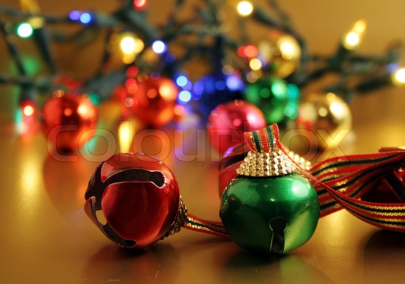 christmas bells with lights in the background stock photo colourbox