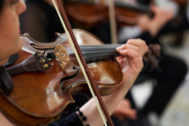 Woman Violinist Playing Classical Violin Music in Musical Performance, stock photo