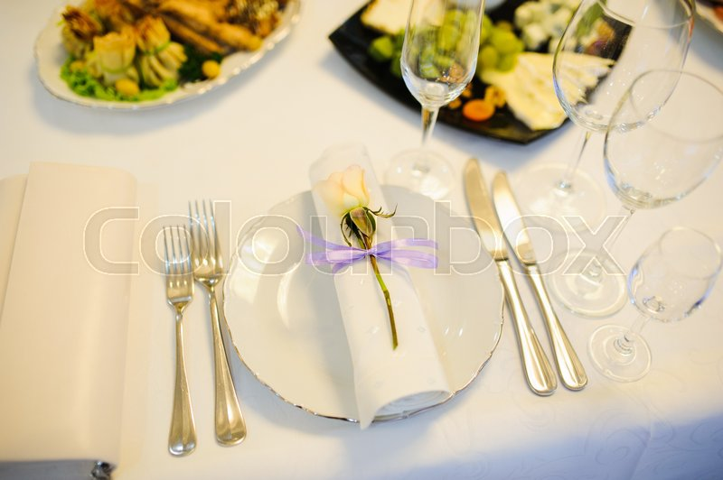 Banquet wedding table setting with plate spoon fork and knife | Stock Photo | Colourbox & Banquet wedding table setting with plate spoon fork and knife ...
