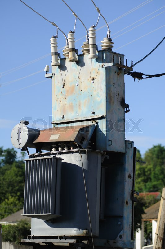 High voltage electricity transformer station against blue sky, stock photo