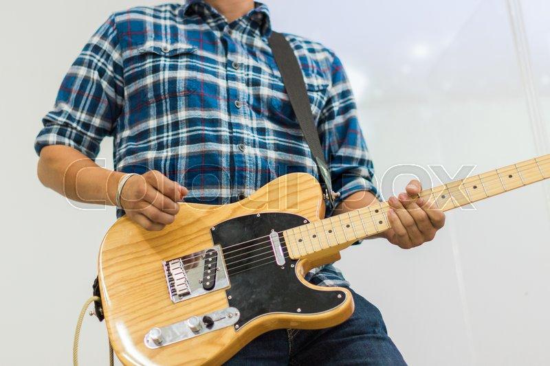 Man guitar player on electric guitar telecaster, stock photo