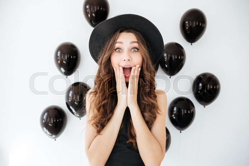 Happy surprised young woman with opened mouth, stock photo