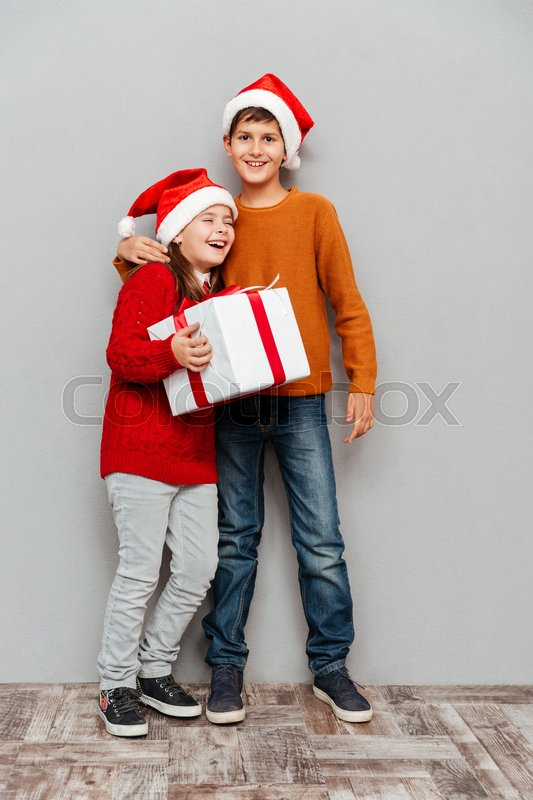 cb0f820d3 Cheerful little boy and girl in santa ...   Stock image   Colourbox