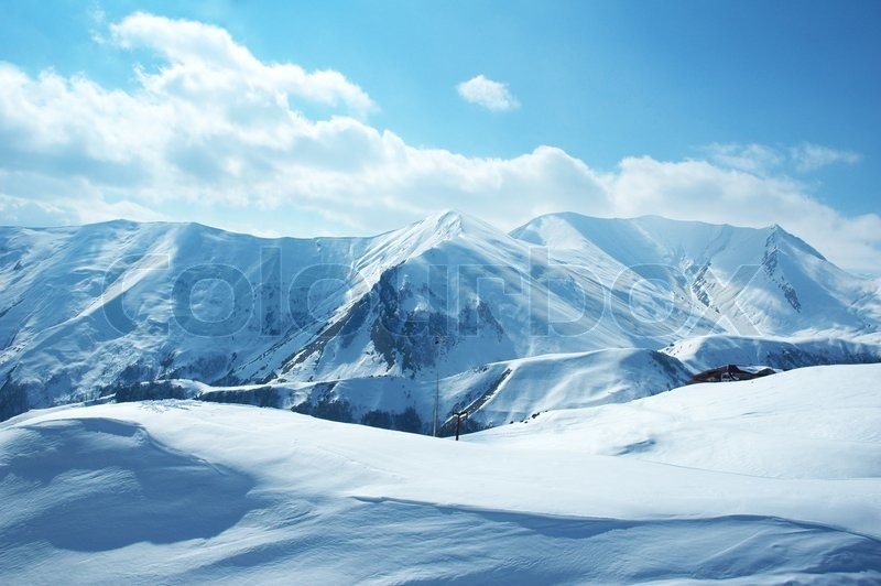 Mountains under the snow on a winter day, stock photo