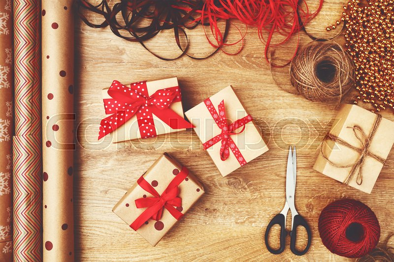 Packaging boxes with Christmas gifts presents on a wooden table, stock photo