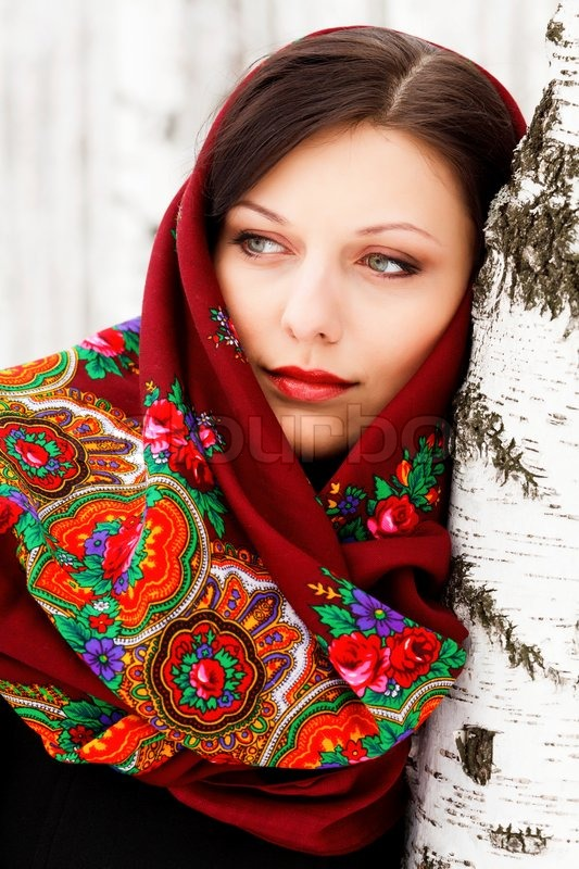 Stock image of 'Gorgeous russian woman in shawl standing by the birch'