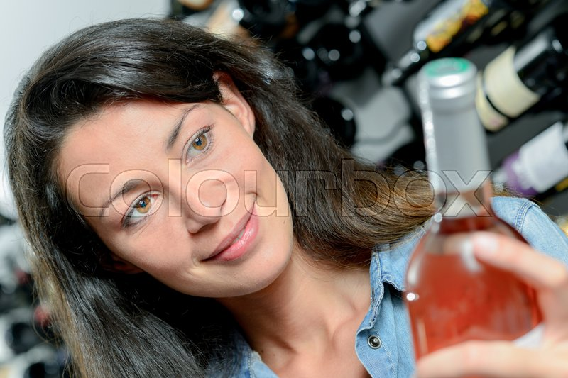 Woman and rose wine, stock photo