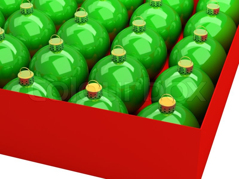 Green Christmas balls in a red box on a white background, stock photo