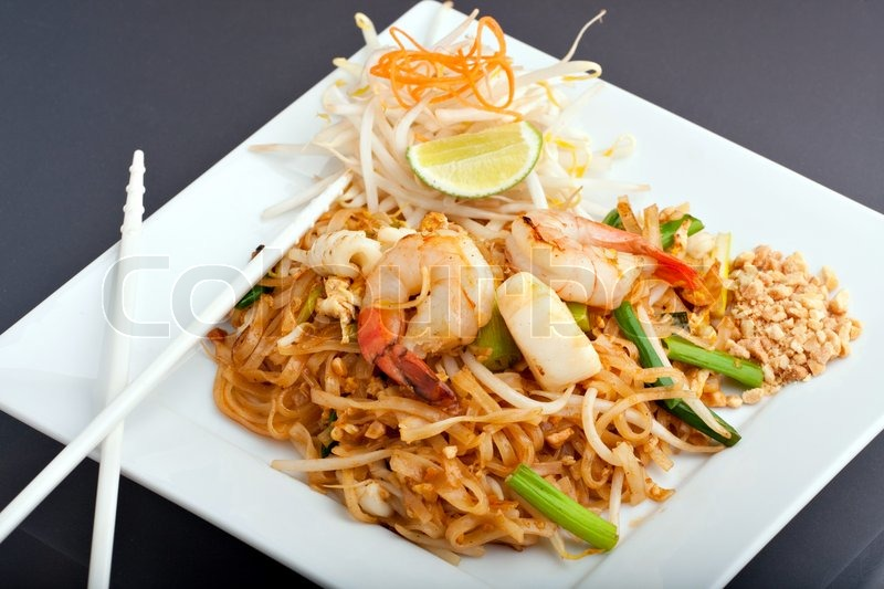 Seafood pad thai dish of thai fried rice noodles on a for American cuisine presentation