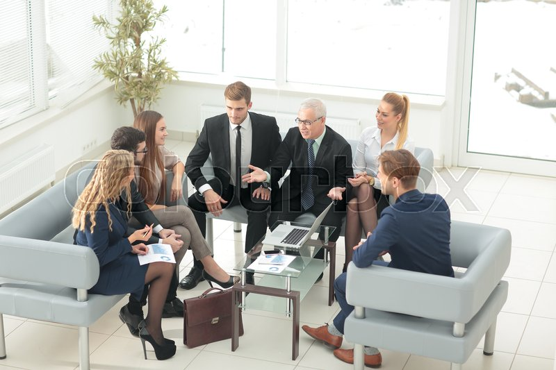 Group of business people with mature businessman leader, stock photo