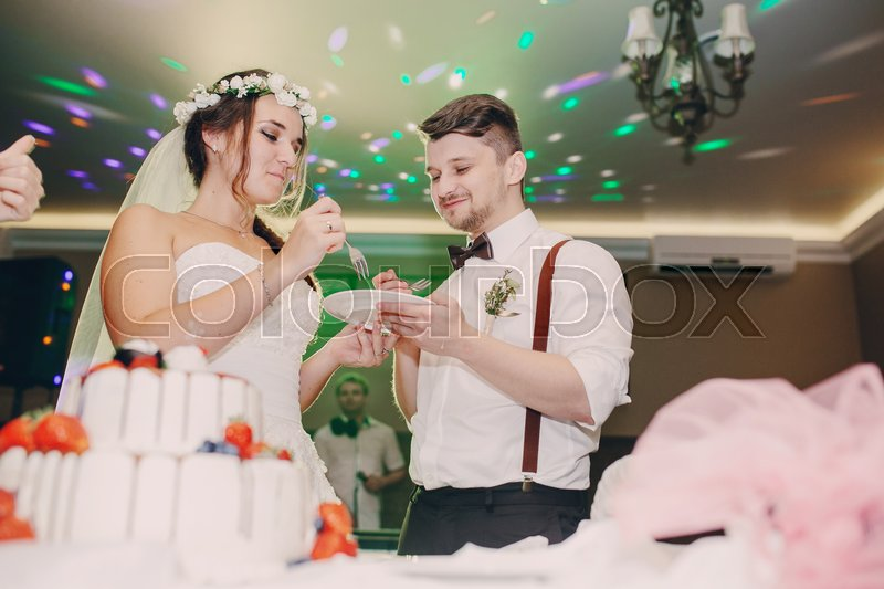 Wedding Couple Cut A Cake In A Stock Image Colourbox