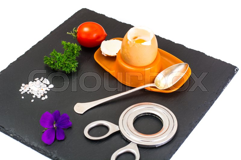 egg cooked soft boiled on black stone plate studio photo stock