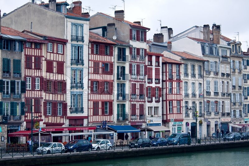 old buildings along bank of nive bayonne france stock photo colourbox. Black Bedroom Furniture Sets. Home Design Ideas