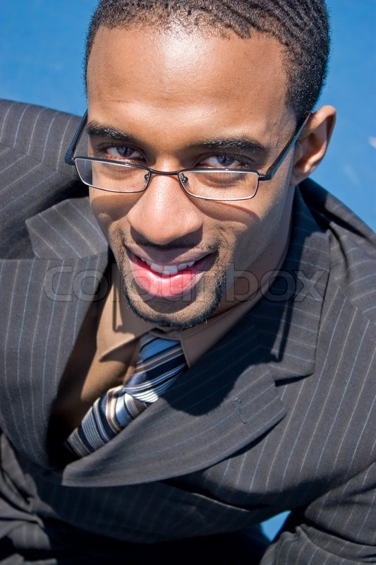 African American Man In A Business Suit With Eye Glasses