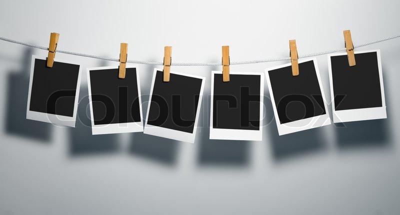 polaroid film blanks on rope attach clothes peg stock photo colourbox. Black Bedroom Furniture Sets. Home Design Ideas