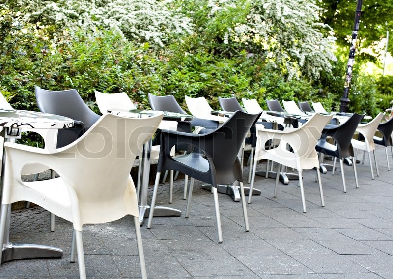Summer Cafe With Empty White Both Black Plastic Tables And Chairs Nearby To  Green Bushes | Stock Photo | Colourbox