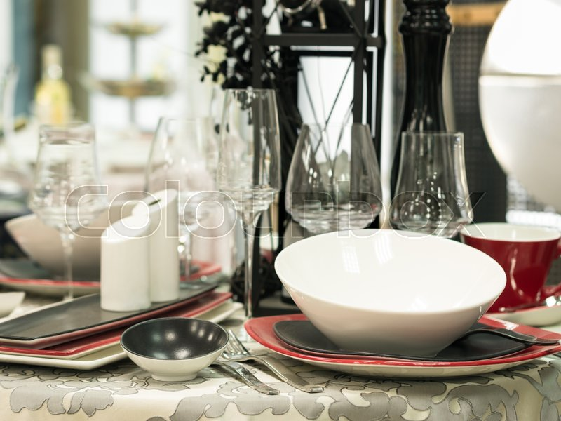 Set of new dishes on table with tablecloth. Shallow DOF, stock photo