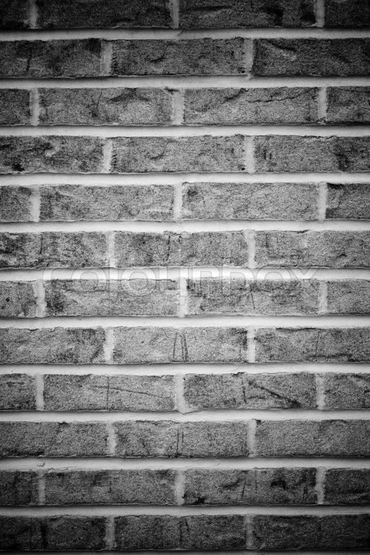 Brick wall background in black and white with vignetting stock photo