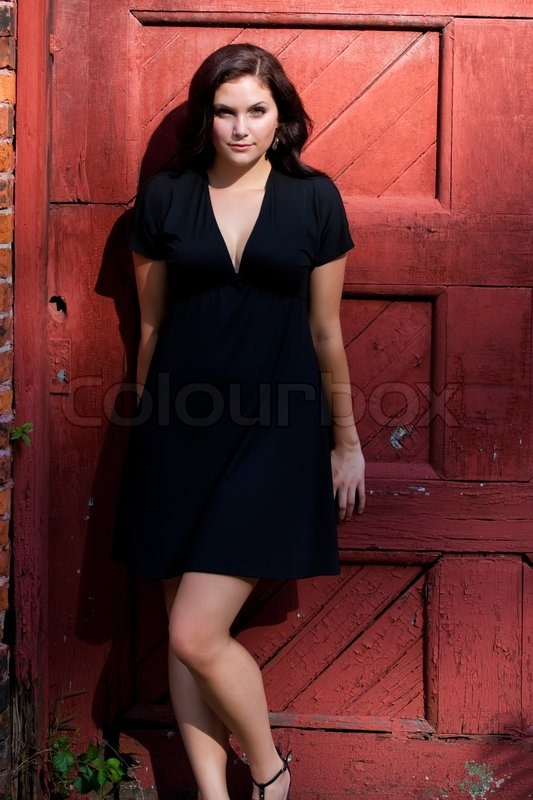 A Pretty Young Woman In A Black Dress Stock Photo Colourbox