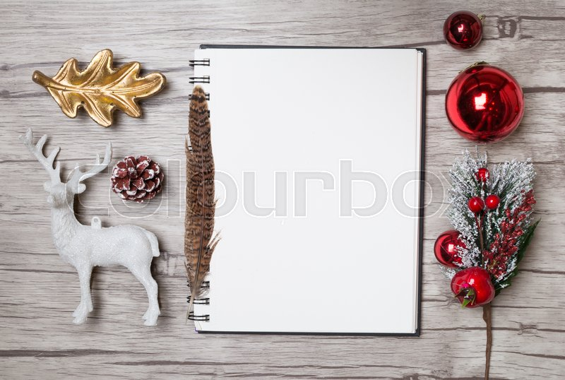 Christmas letter writing on white paper on wooden background with decorations, stock photo