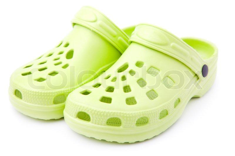 9f3e0875f9de Gummi sandaler på en hvid baggrund