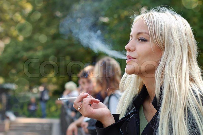 Drunk woman smoking