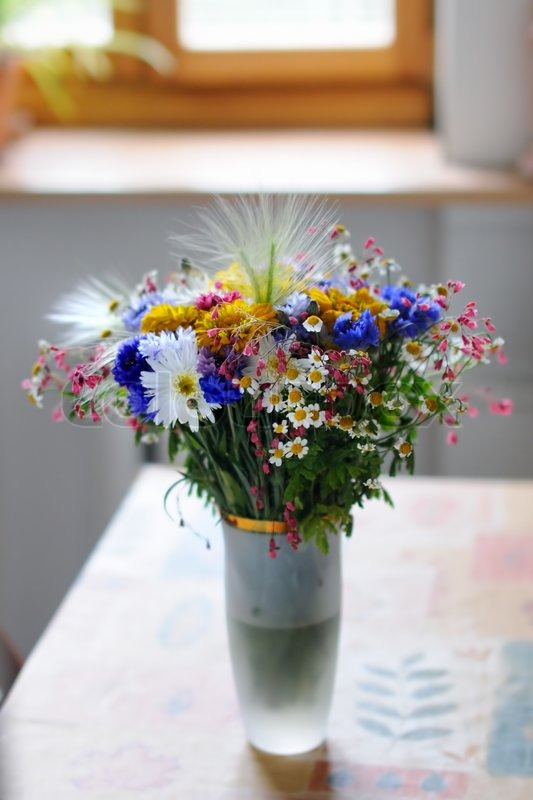 Vase Of Wild Flowers On Table Stock Photo Colourbox