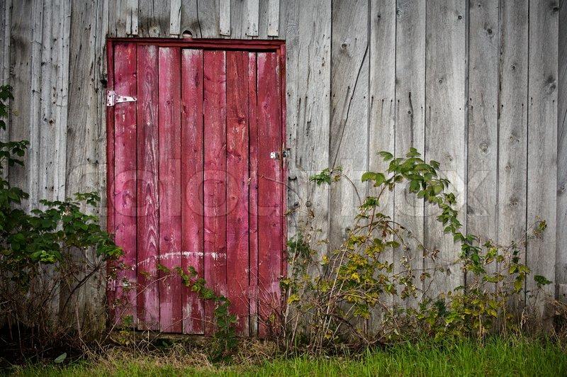 red-door-on-old-wooden-barn