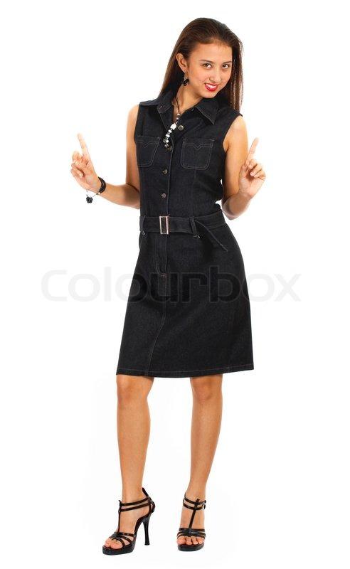 glamorous modell in einem schwarzen kleid und high heels schuhe l chelnd und posing stockfoto. Black Bedroom Furniture Sets. Home Design Ideas