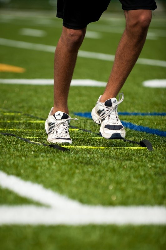 closeup on the legs of somebody running on football field