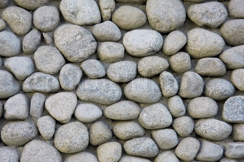 Stone wall texture from river, stock photo