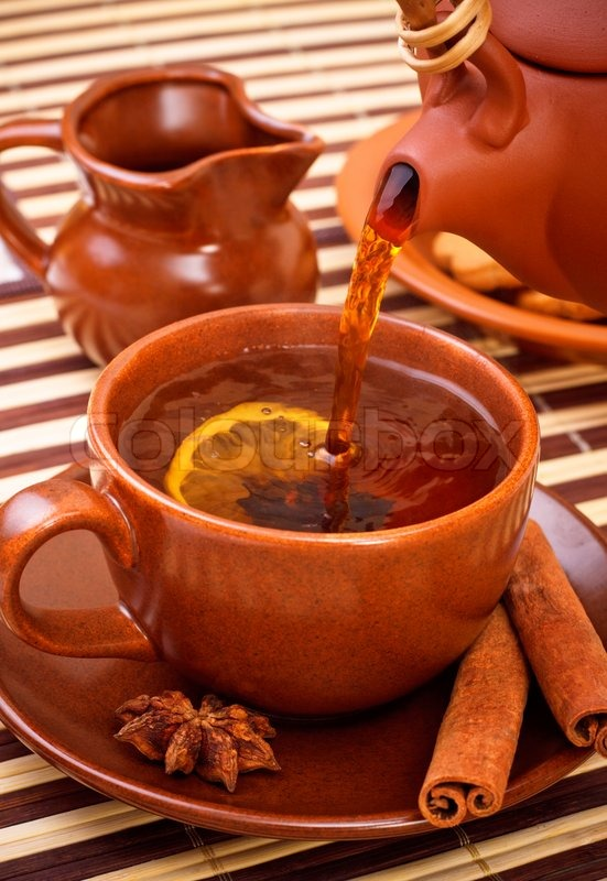 Cup Of Winter Tea With Cinnamon And Star Anise On Bamboo