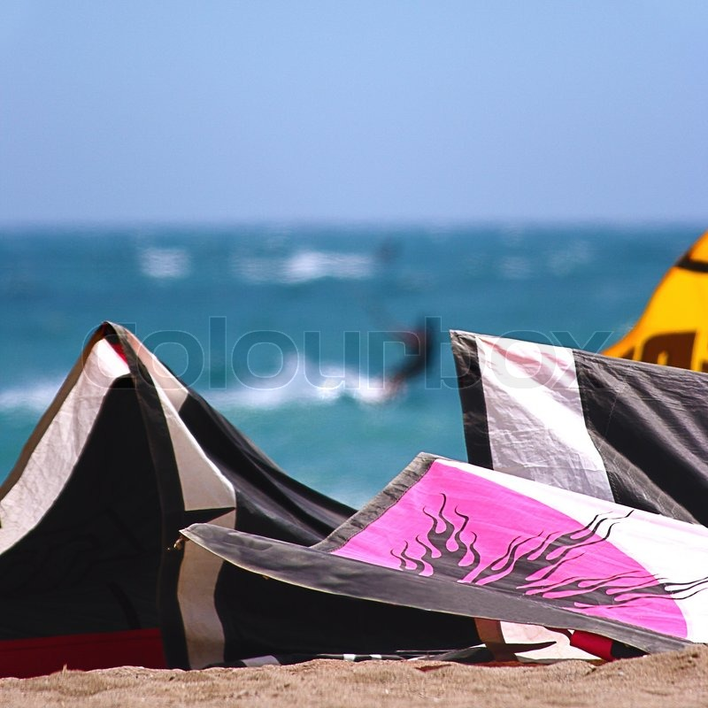View Of Kite Surfing Recreational Activity From The Shoreline, stock photo