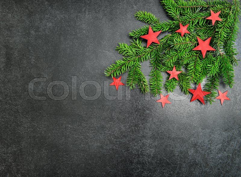Christmas tree branches with decoration red stars. Holidays background, stock photo