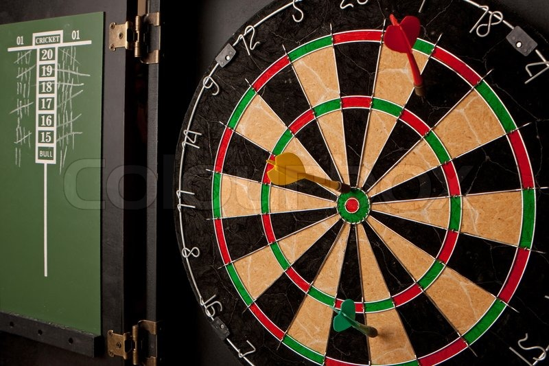A Professional Dart Board Enclosed In A Cabinet With Slate Chalkboard Score  Boards   Stock Photo   Colourbox