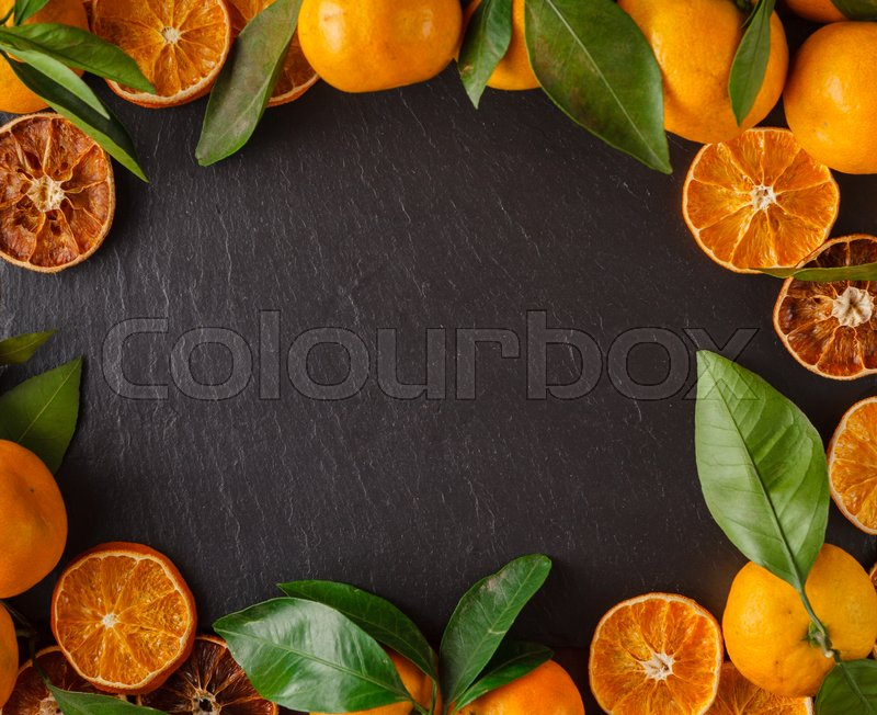 Christmas card with fruit frame of tangerines, stock photo
