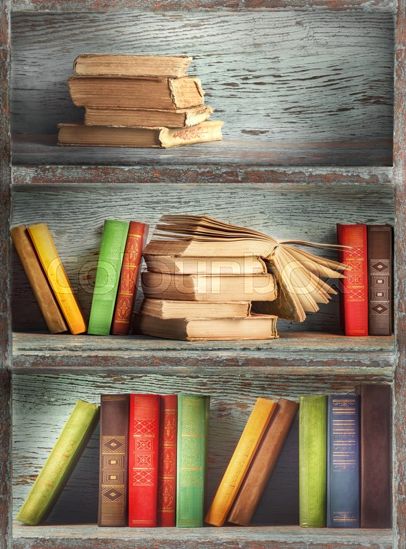 Wooden shelves with books, stock photo