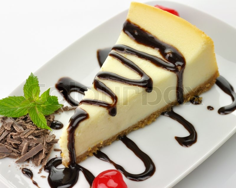 Cake Decoration With Chocolate Syrup : Cheesecake with chocolate sauce Stock Photo Colourbox