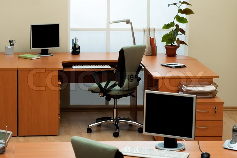 Computers on the desks in a modern office   Stock Photo   Colourbox