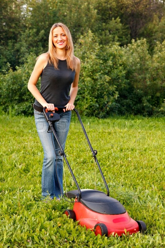 Woman Mowing With Lawn Mower Stock Photo Colourbox