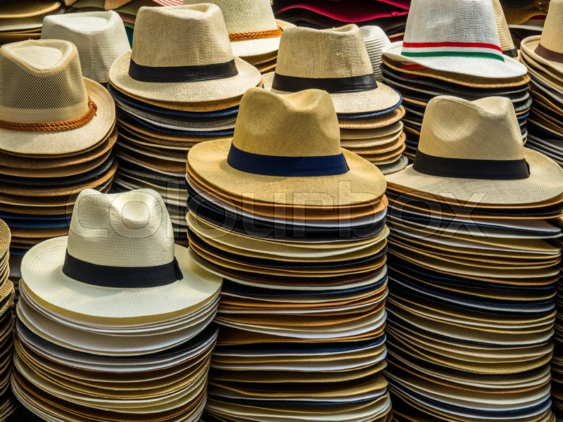Sun hats for men in a market in rome, italy, stock photo